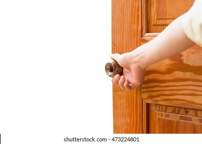 Women hand open door knob or opening the door isolated on white.