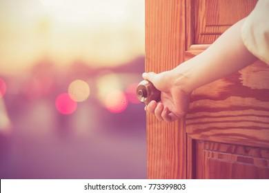 Women hand open door knob or opening the door.