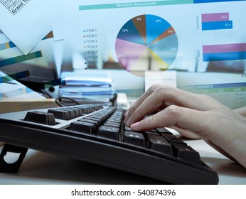 Women hand typing on the keyboard with business chart background. showing data analytic concept.