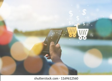 Women hand using smartphone do online selling for people shopping online with chat box, cart, dollar icons pop up. Social media maketing concept.