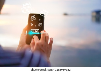 Women hand using smartphone do online shopping screen with many icons   such as  buy icon, dollar symbol and bank note. Social media maketing  concept.