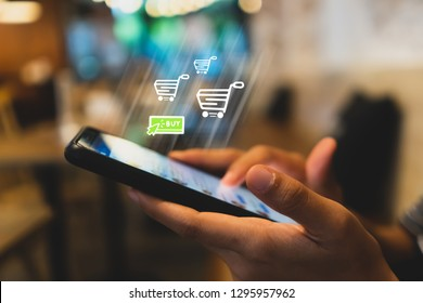 Women hand using smartphone do online selling for people shopping online in black friday with chat box, cart, dollar icons pop up. Social media maketing concept.