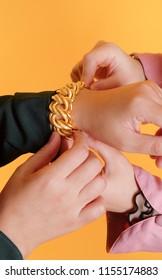 Women hand wearing gold bracelet