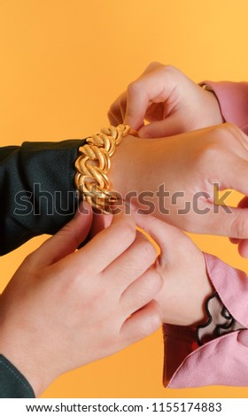 Women hand wearing gold bracelet