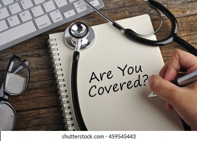 """Women Hand Write """"ARE YOU COVERED"""" On Note Book"""