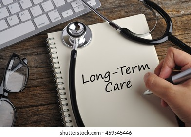 """Women Hand Write """"LONG-TERM CARE"""" On Note Book"""