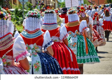 Women in hand-made folk costumes during the traditional parade in Moravia, Czech Republic. The costumes are usually part of the family heritage and have typical slavic and moravian motives.