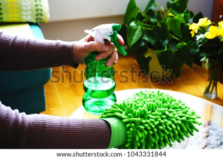 Women hands cleaning glass table in the living room with green glove for  cleaning dust and bdce5520a8