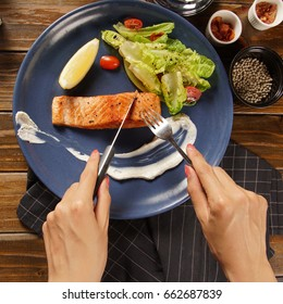 women hands and fork, top view.