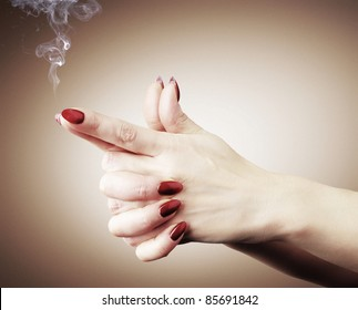 Women hands or gun with smoke, stylize color concept