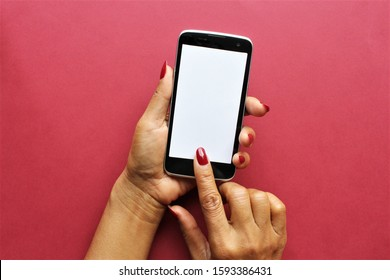 Women hands holding smartphone put index finger on screen.photo
