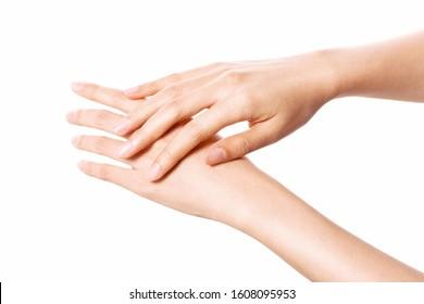 Women hands isolated on white, applying cream, massaging