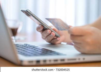 Women hands making online payment with laptop for shoping