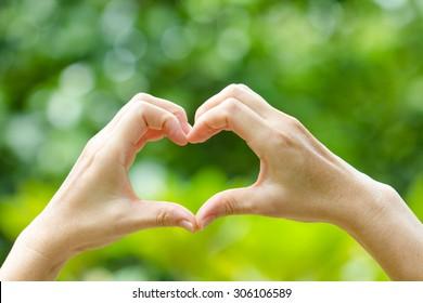 women hands in shape of heart