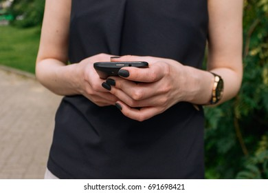 A women hands with smartphone.