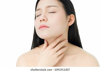 women hands are touching the neck because there is a red rash around the neck, a gray background gives soft light.