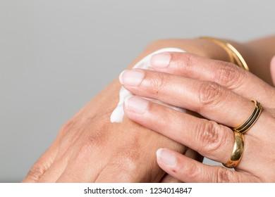 women hands using skin cream