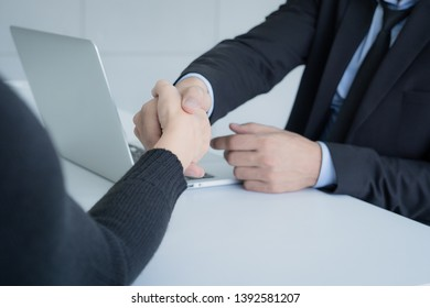 women handshake with businessman while job interviewing, Successful business interview Concept