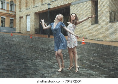 Women are happy with the rain, they are happy and dancing in the rain.