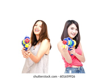 Women happy travelers Holding a water gun Festival celebrate national culture party in Bangkok Thailand tradition New year call Song Kran festival on white background. Thailand New year concept.