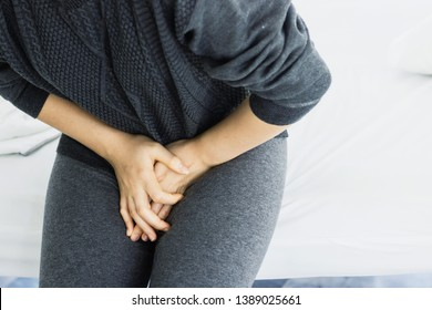 Women have abdominal pain.On bed in bedroom in the morning