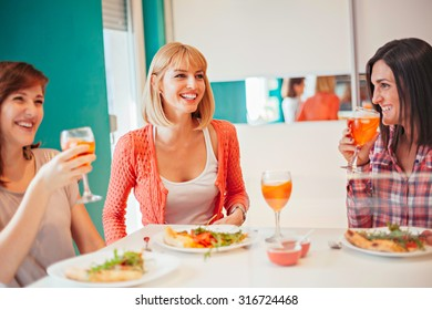 Women Having Fun And Drinking Aperol Spritz At Home