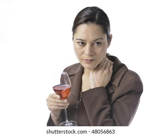 Women having a glass of red wine.She is looking a little sad.White background in studio shot. Women is wearing a wedding ring.
