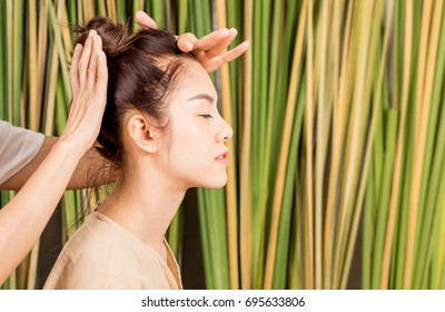 Women is having head massage relaxation on tree background in a salon spa. For healthy wellness natural lifestyle concept.