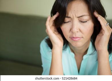 Women with a headache.