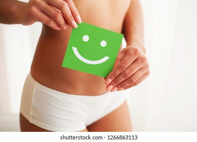 Women Health. Beautiful Female Body In Panties With Smile Card.