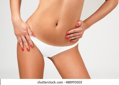 Women health and intimate hygiene. Beautiful Woman's body with smooth soft skin in white bikini panties. Epilation Concepts