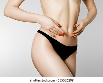 Women health and intimate hygiene. Beautiful Woman's body with smooth soft skin in black bikini panties. Epilation Concepts