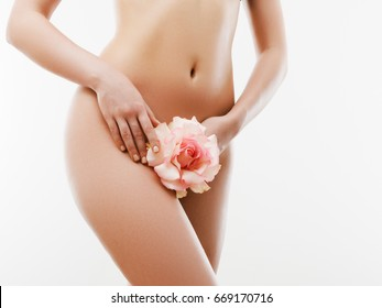 Women health and intimate hygiene. Beautiful Woman's body with smooth soft skin with flower. Epilation Concepts