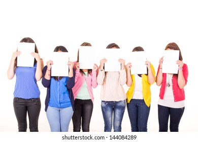 Women hiding their faces behind blank signs