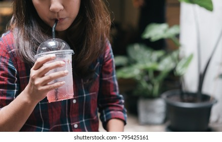 women hold a cup of rose tea