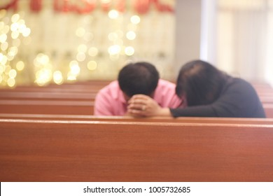 Women hold hands with men, pray for God in church.blurred photo