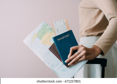 Women hold passports, air tickets, credit cards  With luggage.
