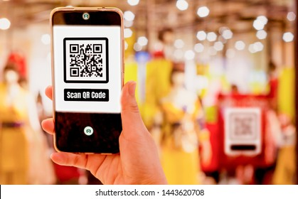 Women hold smartphones in hand,scanning store QR code to check prices,receive promotions and discounts,cashless society concept ,application for shopping,fast communication and modern technology 4.0
