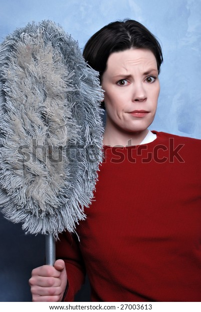 women holding broom irritated by chores
