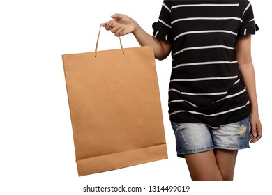 Women holding brown shopping paper bag isolated on white background.
