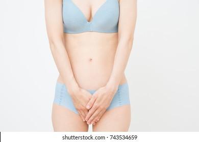 Women holding crotch