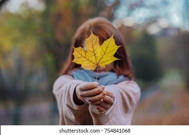 Women holding a leaf