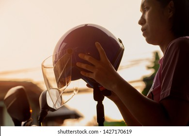 Women holding motorcycles helmet.Concepcion is protecting the head from an accident when riding a motorcycle.