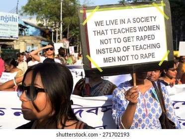 A women holding a poster against rape at women day rally on March 19, 2015 in Calcutta, India