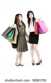 women holding shopping bags against a white background