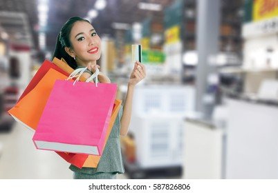 women holding shopping bags and shopping card in her hand with copy space