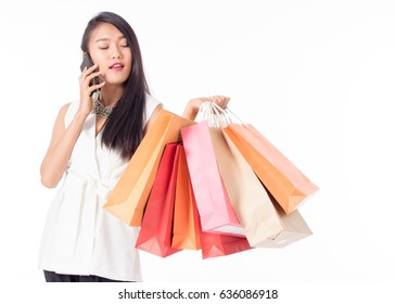 women holding shopping bags in her hand and taking phone with a copy space,isolated on white background