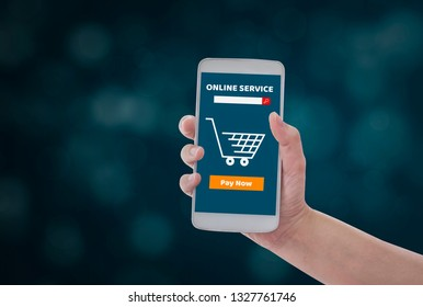 Women holding smartphone in hands with add to cart product to purchase online on blue bokeh background, With  shopping online concept  simplicity and convenience of technology