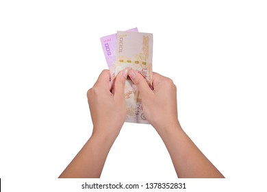 Women holding a thousand and five hundred baht (1,500 baht.) isolated on white background.