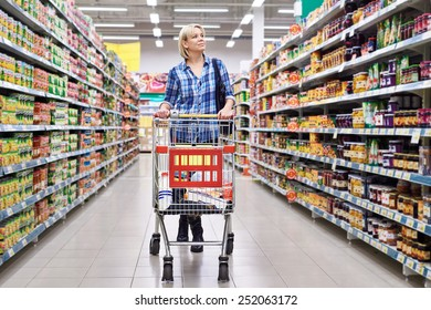 Women housewife with cart shopping in supermarket